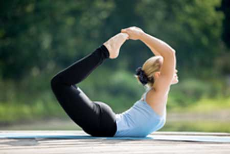 Bow pose helps in strengthening the abdominal muscles