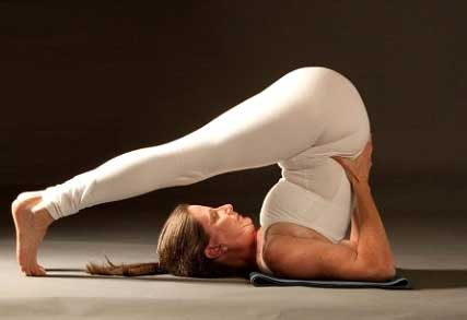 Plow pose helps in releasing the strain and stress off the brain