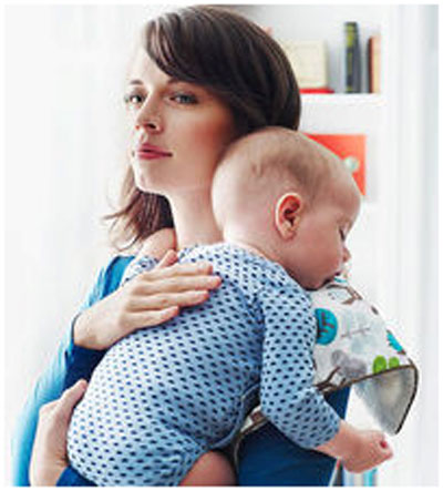 By holding the baby on your shoulder or chest
