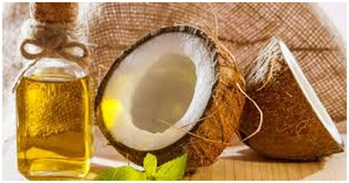 Coconut Oil & Lemon Massage to control dandruff